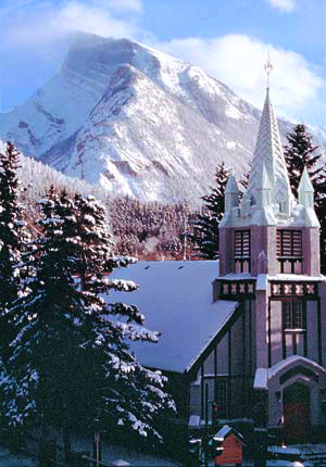 St. Paul's Church in Banff with a snow-capped Mt. Rundle.