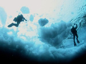 Try your hand at ice diving in Lake Minnewanka in the Canadian Rockies' Banff National Park.